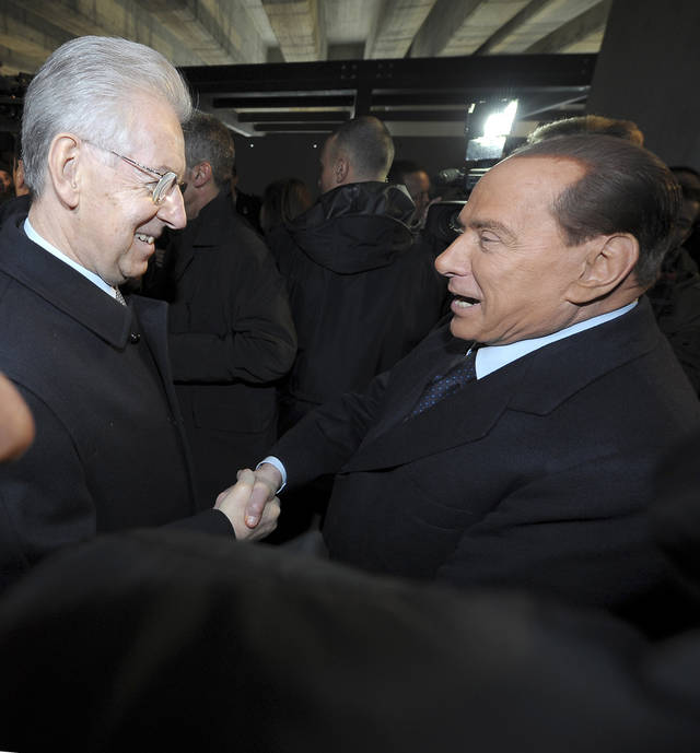 "Italian Premier Mario Monti, left, and former Premier Silvio Berlusconi shake hands in Milan, Italy, Sunday, Jan. 27, 2013. Silvio Berlusconi says Benito Mussolini did much good, except for dictator's regime's anti-Jewish laws. Berlusconi also defended Mussolini for siding with Hitler, saying the late fascist leader likely reasoned that German power would expand so it would be better for Italy to ally itself with Germany. He was speaking to reporters Sunday on the sidelines of a ceremony in Milan to commemorate the Holocaust. When Germany's Nazi regime occupied Italy during World War II, thousands from the tiny Italian Jewish community were deported to death camps. In 1938, before the war's outbreak, Mussolini's regime passed anti-Jewish laws, barring them from universities and many professions, among other bans. Berlusconi called the laws Mussolini's ""worst fault"" but insisted that in many other things, ""he did good."" (AP Photo/Antonio Calanni)"