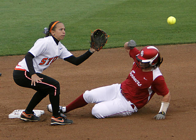 Oklahoma's Keilani Ricketts (10) slides into second base as Oklahoma State's Chelsea Garcia (8) waits for the throw during the bedlam softball game between the University of Oklahoma Sooners and the Oklahoma State University Cowgirls on Wednesday, April 11, 2012, in Stillwater, Oklahoma. Photo by Chris Landsberger, The Oklahoman