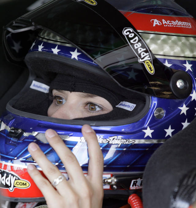 Danica Patrick checks her helmet in her car during practice for the NASCAR Sprint Cup Series auto race at Chicagoland Speedway in Joliet, Ill., Friday, Sept. 14, 2012. (AP Photo/Nam Y. Huh)