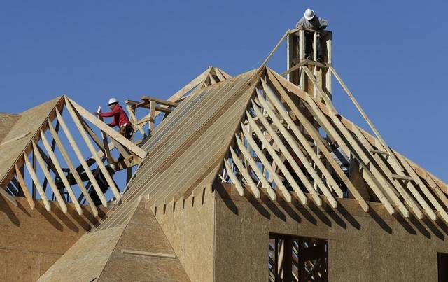 In this Wednesday, Feb. 6, 2013, photo, workers install a roof on a home under construction in Charlotte, N.C Confidence among U.S. homebuilders slipped this month from the 6½ year high it reached in January. Many builders reported less traffic by prospective customers before the critical spring home-buying season.  (AP Photo/Chuck Burton)