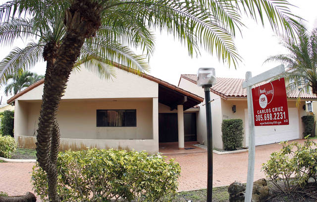 In this Thursday, Sept. 27, 2012, file photo, shows a home for sale in Miami Lakes, Fla. The number of Americans who signed contracts to buy homes rose only slightly in September, suggesting sales may level off in the coming months after solid gains in the past year. The National Association of Realtors said Thursday that its seasonally adjusted index of sales agreements rose in September to a reading of 99.5. That's up from August's reading of 99.2 but below a two-year high of 101.9 reached in July. Contracts are up 14.5 percent from a year ago. (AP Photo/Alan Diaz)