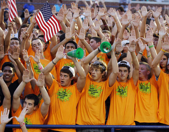 Edmond Santa Fe fans raise their hands for a kickoff during a high school football game between Edmond Santa Fe and Southmoore at Wantland Stadium in Edmond, Okla., Thursday, Sept. 20, 2012. Photo by Nate Billings, The Oklahoman