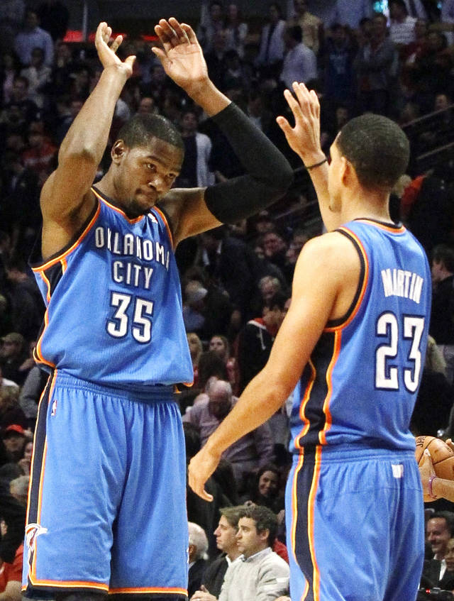 CELEBRATION: Oklahoma City Thunder small forward Kevin Durant, left, celebrates with Kevin Martin during the final seconds of an NBA basketball game against the Chicago Bulls, Thursday, Nov. 8, 2012, in Chicago. The Thunder won 97-91. (AP Photo/Charles Rex Arbogast) ORG XMIT: CXA111