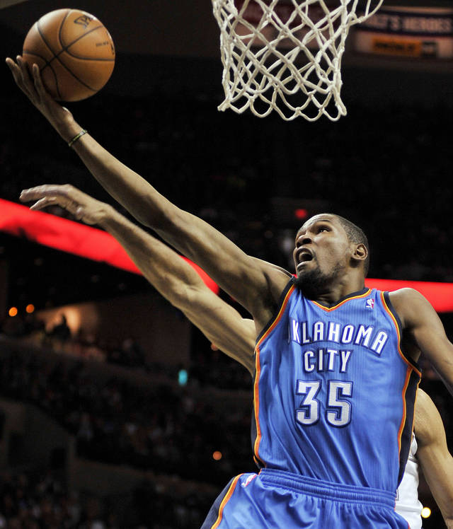 Oklahoma City Thunder's Kevin Durant shoots  against the San Antonio Spurs during the second half of an NBA basketball game, Monday, March 11, 2013, in San Antonio. San Antonio won 105-93. (AP Photo/Darren Abate) ORG XMIT: TXDA108