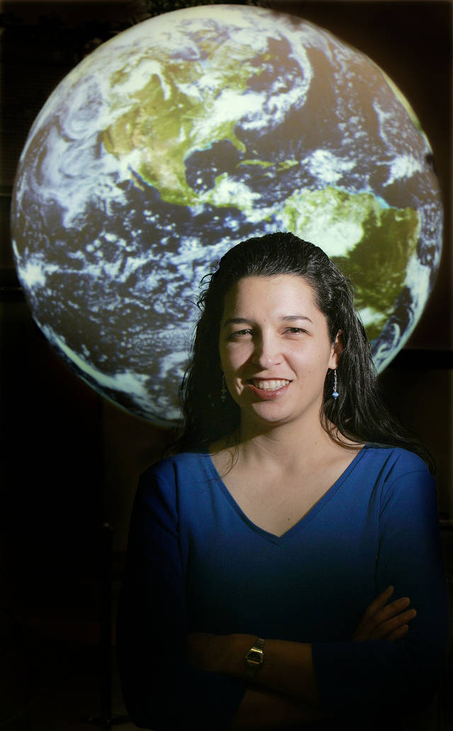 Daphne Thompson with the National Weather Center is shown at the Science on a Sphere in the National Weather Center in Norman.The Oklahoman Archives Photo