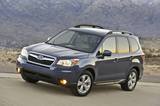 FILE - This publicity file photo provided by Subaru shows the 2014 Subaru Forester, well known as a durable and eminently functional compact sport utility vehicle, adds more power, more room, more safety features and a retuned suspension for 2014. The new, fourth-generation Forester also has higher fuel economy ratings than its predecessor, 24 miles per gallon in city driving and 32 mpg on the highway with base, 170-horsepower, four-cylinder engine and fuel-efficient continuously variable transmission (CVT).  (AP Photo/Subaru, File)