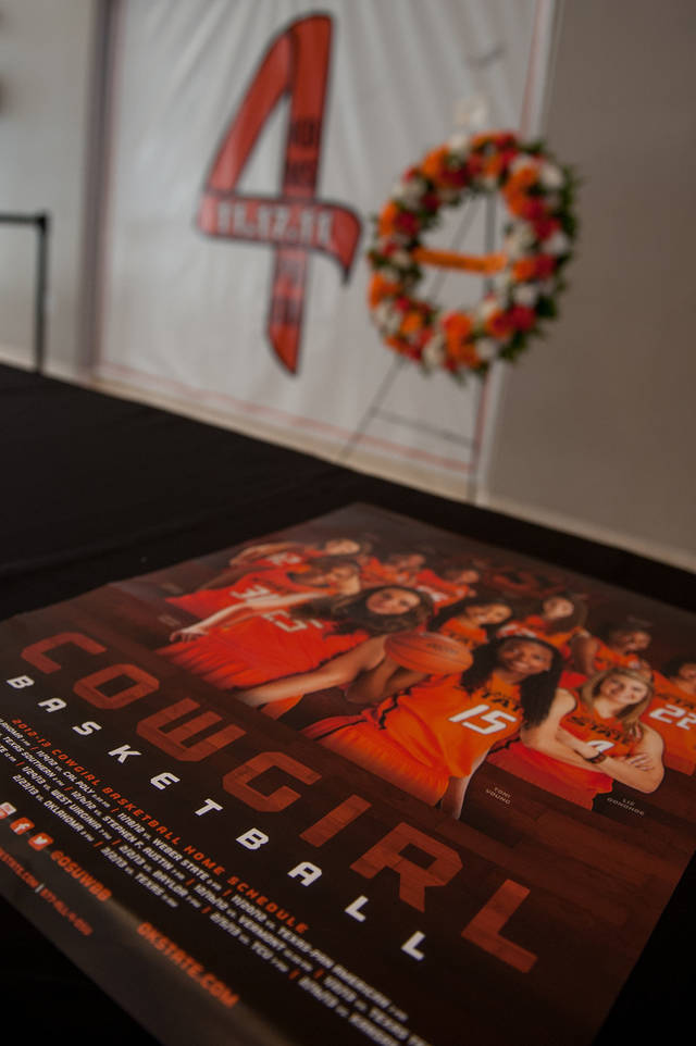"A table displays the 2012-2013 Cowgirl basketball schedule poster in front of the ""Remember the 4"" banner Friday in Gallagher-Iba Arena in Stillwater. Saturday is the first anniversary of the airplane crash that killed two Oklahoma State University women's basketball coaches and two OSU supporters. Photo by Mitchell Alcala for The Okahoman <strong>Mitchell Alcala - Mitchell Alcala for the Oklahoma</strong>"