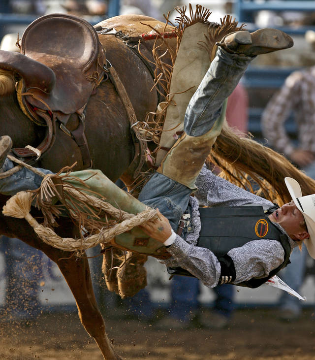 Tyke Kipp of Lordsburg, N.M., falls off his horse in the saddle bronc event during the International Finals Youth Rodeo in Shawnee, Okla., Friday, July 16, 2010.  Photo by Bryan Terry, The Oklahoman