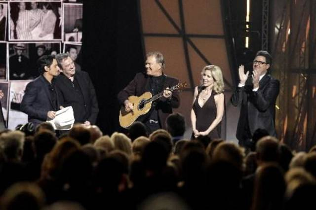 From left, Brad Paisley, Jimmy Webb, Glen Campbell, Campbell's wife Kim, and Vince Gill, are seen onstage during a tribute to Glen Campbell at the 45th Annual Country Music Association Awards in Nashville, Tenn., on Wednesday, Nov. 9, 2011. (AP file)