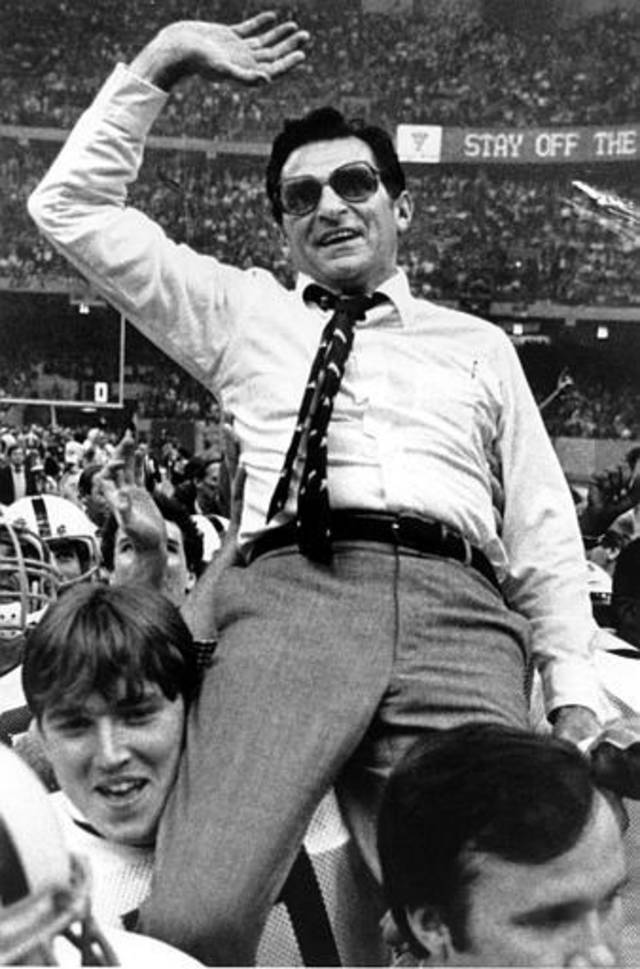 Penn State head coach Joe Paterno waves as he gets a victory ride in the Louisiana Superdome Saturday night after his Nittany Lions beat Georgia in the Sugar Bowl, 27-23, in New Orleans, La., on Jan. 1, 1983.  (AP Photo/Bill Feig)