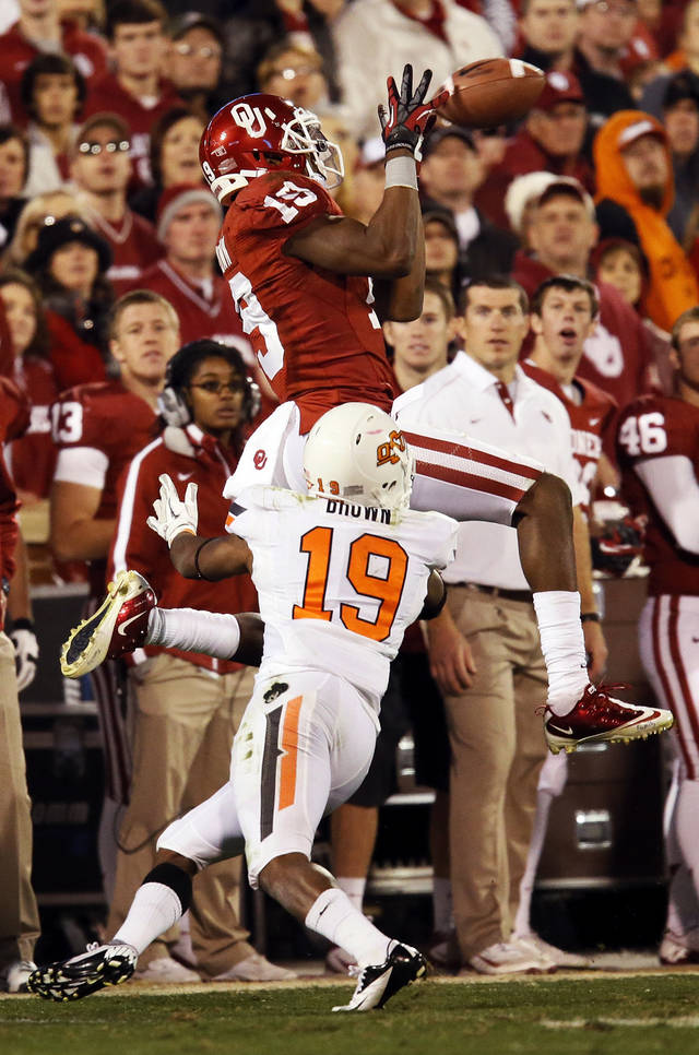 Oklahoma's Justin Brown (19) catches a pass against Oklahoma State's Brodrick Brown (19) in the fourth quarter during the Bedlam college football game between the University of Oklahoma Sooners (OU) and the Oklahoma State University Cowboys (OSU) at Gaylord Family-Oklahoma Memorial Stadium in Norman, Okla., Saturday, Nov. 24, 2012. OU won, 51-48 in overtime. Photo by Nate Billings , The Oklahoman
