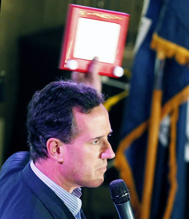 Rick Santorum holds an Etch A Sketch during a rally Wednesday in Mandeville, La. AP Photo