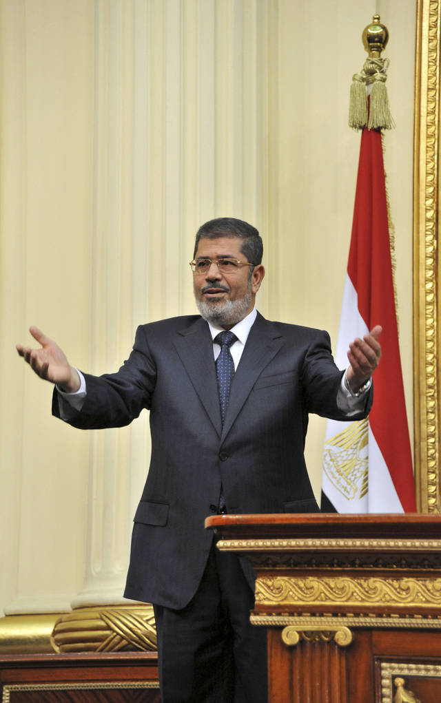 "In this image released by the Egyptian Presidency, Mohammed Morsi addresses the newly convened upper house of parliament in Cairo, Egypt, Saturday, Dec. 29, 2012.  Egypt's Islamist president warned against any unrest that could harm the drive to repair the country's battered economy in his first address before the newly convened upper house of parliament on Saturday, urging the opposition to work with his government. In the nationally televised speech, Mohammed Morsi said the nation's entire efforts should be focused on ""production, work, seriousness and effort,"" now that a new constitution came into effect this week, blaming protests and violence the last month for causing further damage to an economy already in crisis since the fall of autocrat Hosni Mubarak. (AP Photo/Egyptian Presidency)"