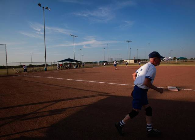 Loal Buttram runs onto the field during a game at the Plex Sports Complex in Oklahoma City, July 5, 2011.  Photo by Garett Fisbeck, The Oklahoman