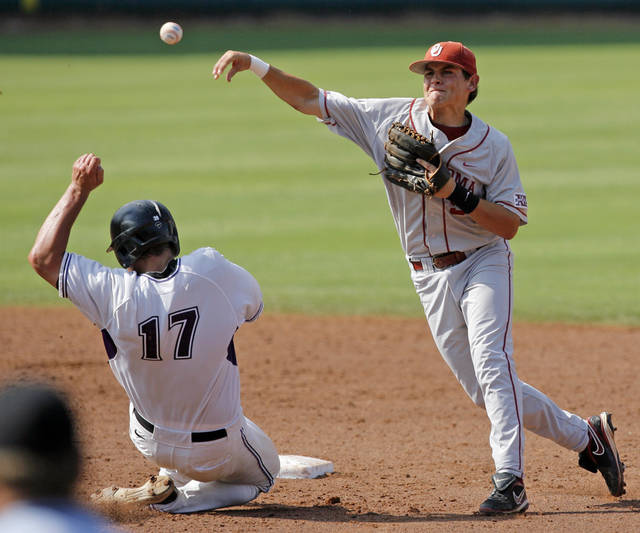 OU's Caleb Bushyhead throws back to first base over KSU's Kent Urban to complete a double play in the third inning during the Big 12 baseball championship tournament game between Kansas State and Oklahoma at the Bricktown Ballpark in Oklahoma City, Saturday, May 29, 2010. OU won, 13-2, in eight innings. Photo by Nate Billings, The Oklahoman