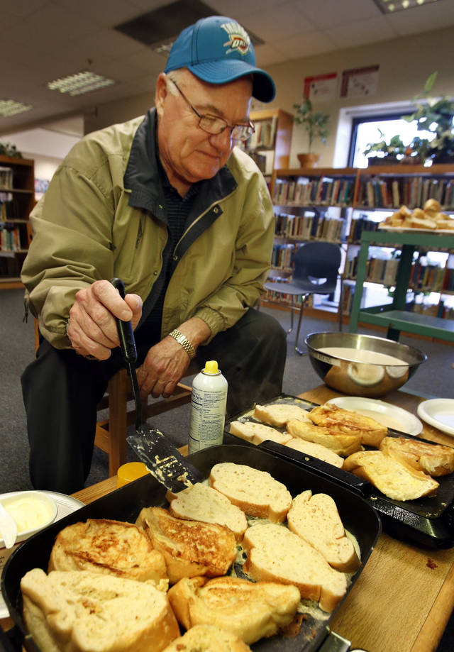 Western Heights Superintendent of Schools Joe Kitchens cooks french toast for participants as Western Heights Middle School kicks off its first day of training for its One Kid Challenge program on Saturday, Dec. 15, 2012, in Oklahoma City, Okla.  Photo by Steve Sisney, The Oklahoman