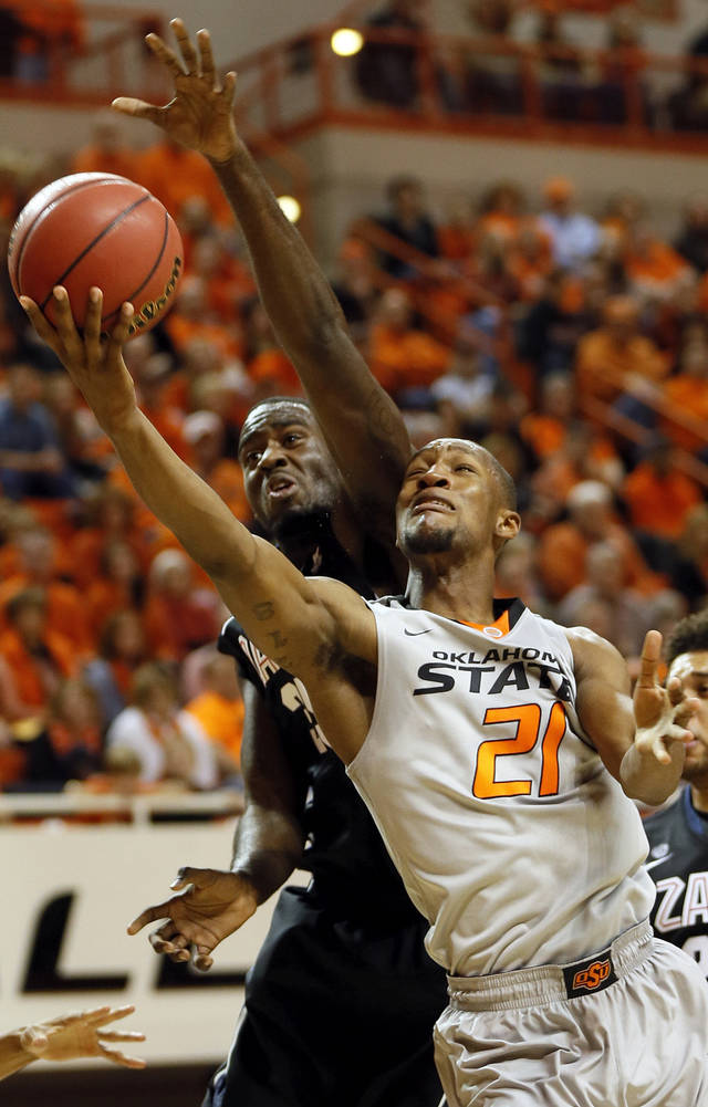 Oklahoma State's Kamari Murphy (21) shoots in front of Gonzaga's Sam Dower (35) during a men's college basketball game between Oklahoma State University (OSU) and Gonzaga at Gallagher-Iba Arena in Stillwater, Okla., Monday, Dec. 31, 2012. Photo by Nate Billings, The Oklahoman