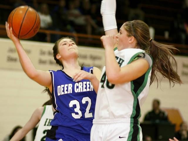 Deer Creek's Bayli Blanchard tries to shoot the ball beside Elyse Hight of Bishop McGuinness during the Class 5A girls basketball area tournament in Norman, Okla., Saturday, March 3, 2012. Photo by Bryan Terry, The Oklahoman