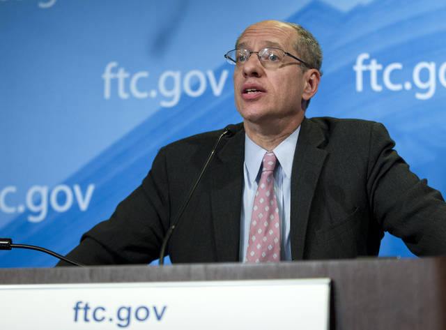 Federal Trade Commission (FTC) Chairman Jon Leibowitz speaks during a news conference at FTC in Washington, Thursday, Jan. 3,  2013, to announce that Google is agreeing to license certain patents to mobile phone rivals and stop a practice of including snippets from other websites in its search results as part of a settlement to end a 19-month investigation in the search leader's business practices. ( AP Photo/Jose Luis Magana