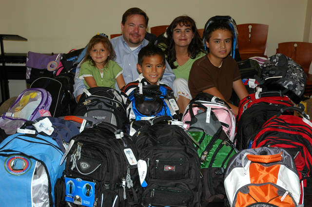 100 School Bags Distributed. Crystal Morris, Brian Morris, Brendan Calderwood, Olivia Morris, and Alex Calderwood helped to collect and distribute 100 school bags to children connected to Henderson Hills Baptist Church. www.hendersonhills.com<br/><b>Community Photo By:</b> Jeff Wilson<br/><b>Submitted By:</b> Jeff, Edmond