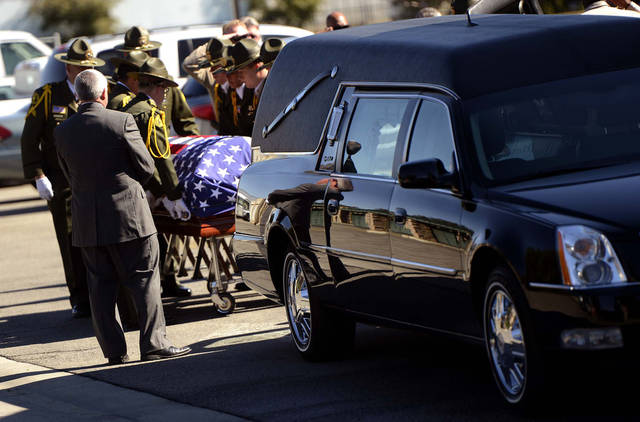 The body of slain San Bernardino County Sheriff's Deputy Jeremiah MacKay is loaded into a hearse at the SBCO Coroner's Office in San Bernardino, Calif. on Thursday, Feb. 14, 2013. MacKay was killed in a shootout outside the cabin in Big Bear, Calif. where fugitive ex-cop Christopher Dorner was barricaded inside. The Department held a small service with Honor Guard, and the playing of bag pipes prior to a procession led by a motorcade to Mountain View Mortuary in San Bernardino. (AP Photo/The Sun, Gabriel Luis Acosta)  VENTURA COUNTY STAR OUT; RIVERSIDE PRESS-ENTERPRISE OUT; THE VICTOR VALLEY DAILY PRESS OUT