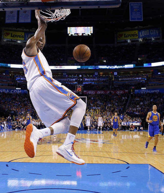 Oklahoma City's Kevin Durant (35) dunks the ball during an NBA basketball game between the Oklahoma City Thunder and the Golden State Warriors at Chesapeake Energy Arena in Oklahoma City, Wednesday, Feb. 6, 2013. Photo by Bryan Terry, The Oklahoman