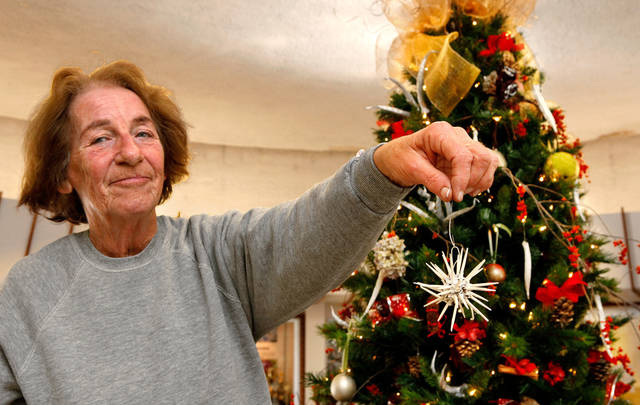 June Hardy shows one of the ornaments to be placed on the nature tree at the Will Rogers Garden Exhibition Center. The tree is adorned with ornaments and decorations made with items found in nature.  Photos by Jim Beckel, The Oklahoman