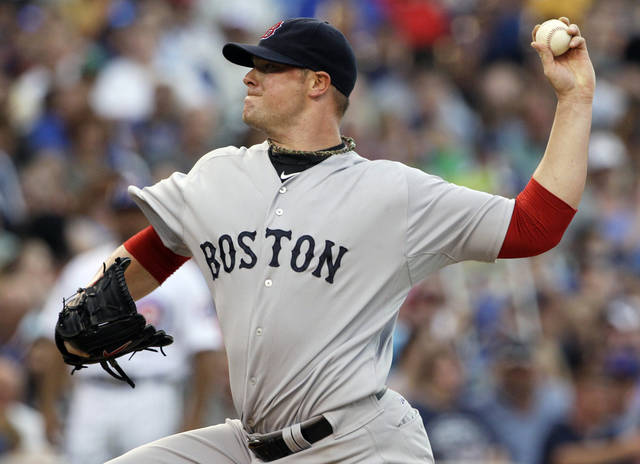 Boston Red Sox starter John Lester delivers a pitch against the Chicago Cubs during the second inning of an interleague baseball game in Chicago, Saturday, June 16, 2012. (AP Photo/Nam Y. Huh)