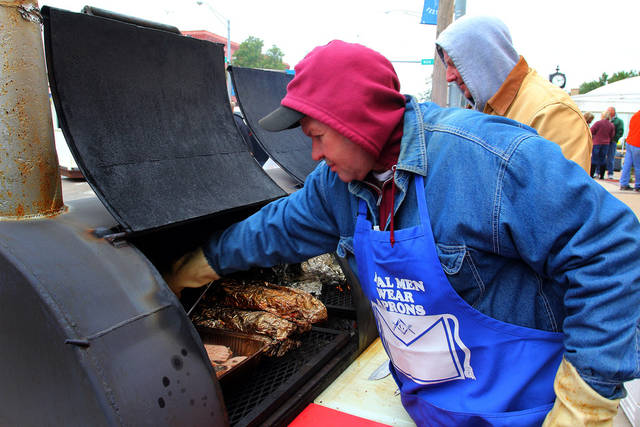 Kevin Hall and Robert Crum of the Yukon Masonic Lodge #90 smoke pork loins for sandwiches during the 47th annual Czech Festival Saturday in Yukon. PHOTO BY HUGH SCOTT FOR THE OKLAHOMAN