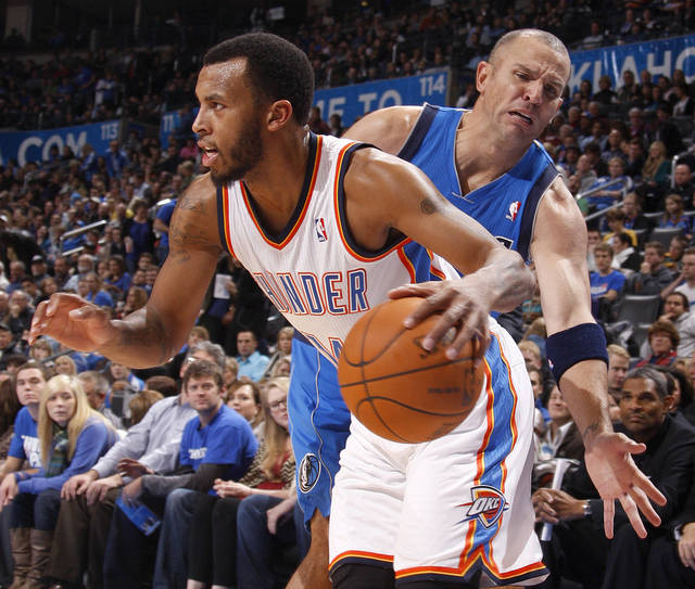 Oklahoma City's' Daequan Cook (14) goes past Dallas' Jason Kidd (2) during a preseason NBA game between the Oklahoma City Thunder and the Dallas Mavericks at Chesapeake Energy Arena in Oklahoma City, Tuesday, Dec. 20, 2011. Photo by Bryan Terry, The Oklahoman