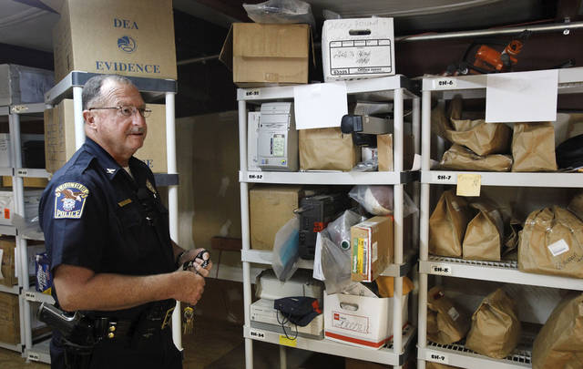 Choctaw Police Chief Conny Clay demonstrates how his department's new property and evidence room will be organized on Thursday, July 26, 2012.  Photo by Jim Beckel, The Oklahoman. <strong>Jim Beckel - THE OKLAHOMAN</strong>