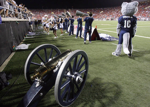 FILE - In this Oct. 2, 2010, file photo the Fremont Canon trophy cannon sits on the sideline before the start of the Nevada-UNLV NCAA college football game in Las Vegas.While many school rivalries have a trophy for their annual game, the new Cy-Hawk trophy for the Iowa and Iowa State game was scrapped Tuesday, Aug. 23, 2011, and will be replaced after complaints about the design. (AP Photo/Isaac Brekken, File)