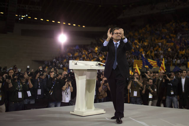 The leader of center-right Catalan Nationalist Coalition (CiU), Artur Mas, thanks his supporters during the last day of campaigning in a meeting in Barcelona, Spain, on Friday, Nov. 23, 2012. Catalonia holds elections on Sunday that will be seen as a test of the regional government's plans to hold a referendum on independence, and one of the key issues emerging is the theoretical place of a free Catalonia in Europe. (AP Photo/Emilio Morenatti)