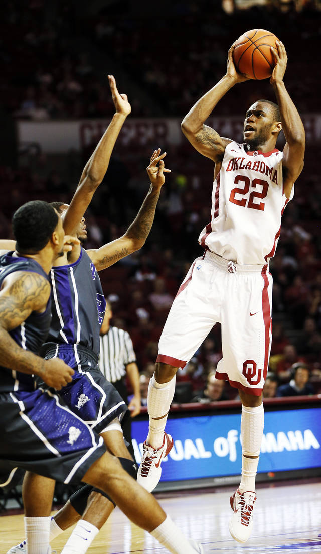 Oklahoma's Amath M'Baye (22) takes a shot during an NCAA men's basketball game between the University of Oklahoma (OU) and Texas Christian University (TCU) at the Lloyd Noble Center in Norman, Okla., Monday, Feb. 11, 2013. Photo by Nate Billings, The Oklahoman