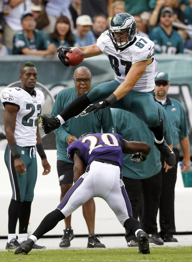 FILE - This Sept. 16, 2012 file photo shows Philadelphia Eagles' Brent Celek, top, hurdling Baltimore Ravens' Ed Reed to avoid a tackle in the second half of an NFL football game in Philadelphia. Celek punctuated his career-best receiving day with the hurdle over Reed that made all the highlight reels. Now the underrated tight end may not go unnoticed anymore. (AP Photo/Mel Evans, File)