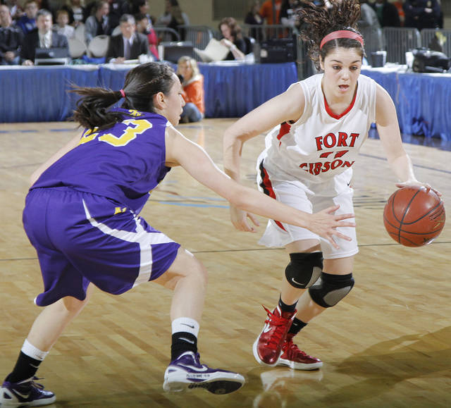 FORT GIBSON / CLASS 4A GIRLS HIGH SCHOOL BASKETBALL / STATE TOURNAMENT: Ft. Gibson's Savannah Gray (11) drives past Anadarko's Lakota Beatty (23) during the 4A girl State Basketball Championship game between Ft. Gibson High School and Anadarko High School at State Fair Arena on Saturday, March 10, 2012 in Oklahoma City, Okla.  Photo by Chris Landsberger, The Oklahoman