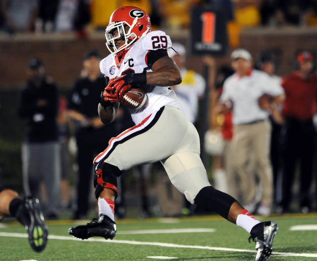 Georgia linebacker Jarvis Jones runs an interception back 21-yards for a touchdown during the fourth quarter of an NCAA college football game against Missouri Saturday, Sept. 8, 2012, in Columbia, Mo. Georgia won 41-20. (AP Photo/L.G. Patterson)