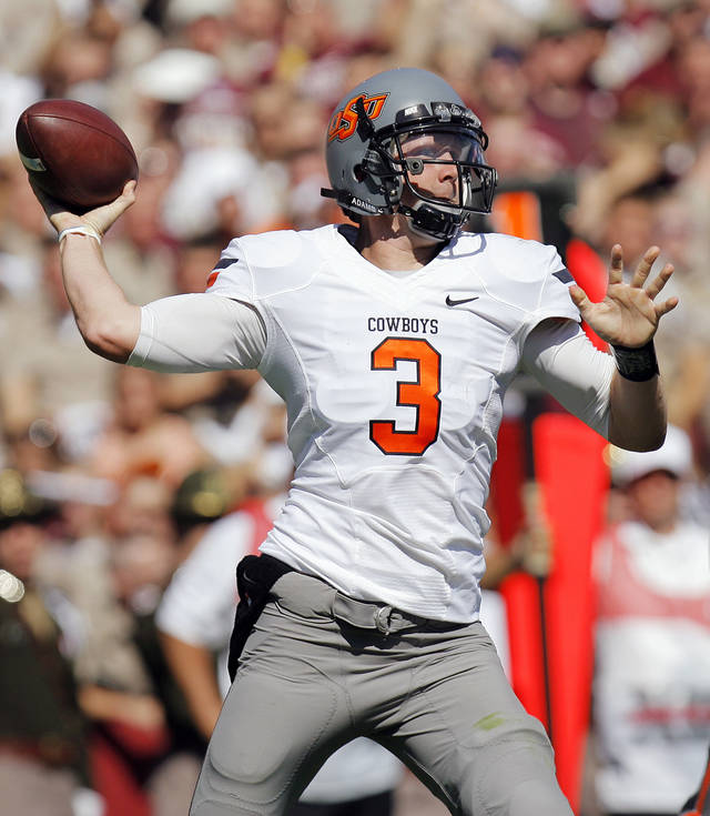 OSU quarterback Brandon Weeden (3) passes in the first half of the Cowboys game vs. Texas A&M on Saturday. Photo by Nate Billings, The Oklahoman