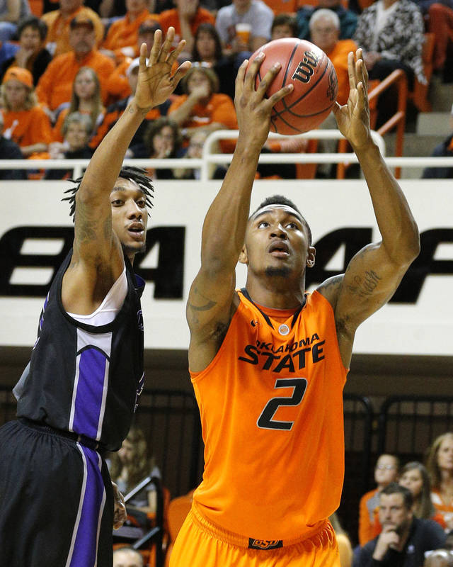 Oklahoma State's Le'Bryan Nash (2) shoots as Central Arkansas' Jarvis Garner (1) defends during the men's college basketball game between Oklahoma State University and Central Arkansas at Gallagher-Iba Arena in Stillwater, Okla., Sunday,Dec. 16, 2012. Photo by Sarah Phipps, The Oklahoman