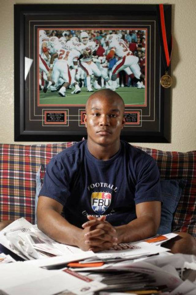 Heritage Hall's Barry Sanders sits in his room with recruitment letters in Oklahoma City, Saturday, Feb. 12, 2011. Photo by Bryan Terry, The Oklahoman <strong>BRYAN TERRY</strong>