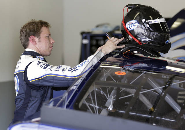 Brad Keselowski rest his helmet on the roof of his car after being out on the track during NASCAR auto race testing at Daytona International Speedway, Thursday, Jan. 10, 2013, in Daytona Beach, Fla. (AP Photo/John Raoux)