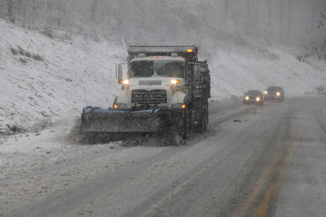 Snow plows thunder through the mountains of West Virginia as the superstorm begins it's raking of the region, Monday evening, Oct. 29, 2012. In the higher elevations of the mountains there could be from 2-3 feet of snow and blizzard conditions thru Tuesday. (AP Photo/Robert Ray) ORG XMIT: WVRR101