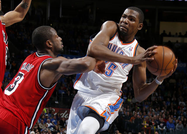 Oklahoma City's Kevin Durant (35) tries to get past Miami's Dwyane Wade (3) during an NBA basketball game between the Oklahoma City Thunder and the Miami Heat at Chesapeake Energy Arena in Oklahoma City, Thursday, Feb. 15, 2013. Miami won 110-100. Photo by Bryan Terry, The Oklahoman