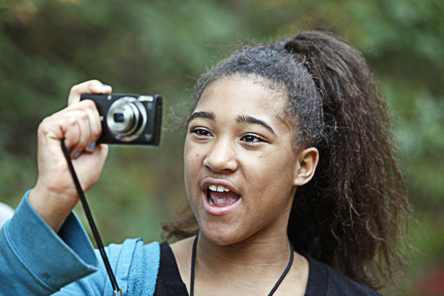 "Katyra, 10, takes photos during an outing with The Boys and Girls Club's new program called ""Parks in Focus"" at the Stinchcomb Wildlife Refuge, Oct. 23, 2012. Photo By David McDaniel/The Oklahoman <strong>David McDaniel - The Oklahoman</strong>"