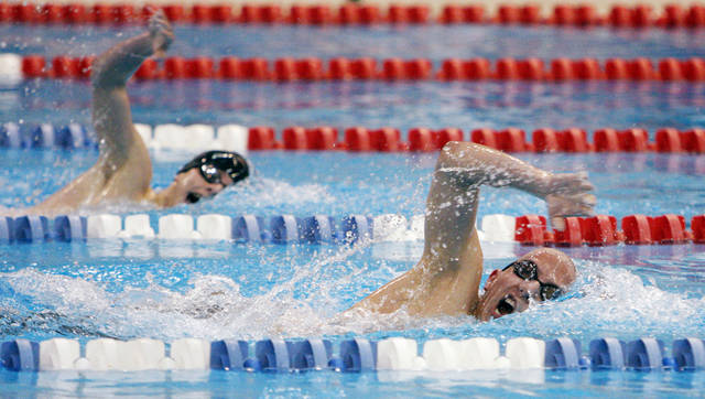 Stillwater's Alex Barto, front right, and Edmond Memorial's Danny Hatfield, back left, compete in the boys 500-yard freestyle during the high school swimming state championships at Oklahoma City Community College in Oklahoma City, February 16, 2008. Barto finished first, while Hatfield finished second. BY NATE BILLINGS, THE OKLAHOMAN