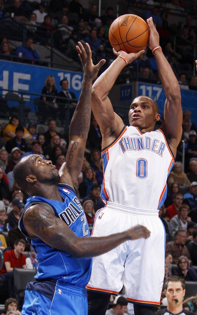 Oklahoma City's' Russell Westbrook shoots the ball beside Dallas' Dominique Jones (20) during a preseason NBA game between the Oklahoma City Thunder and the Dallas Mavericks at Chesapeake Energy Arena in Oklahoma City, Tuesday, Dec. 20, 2011. Photo by Bryan Terry, The Oklahoman