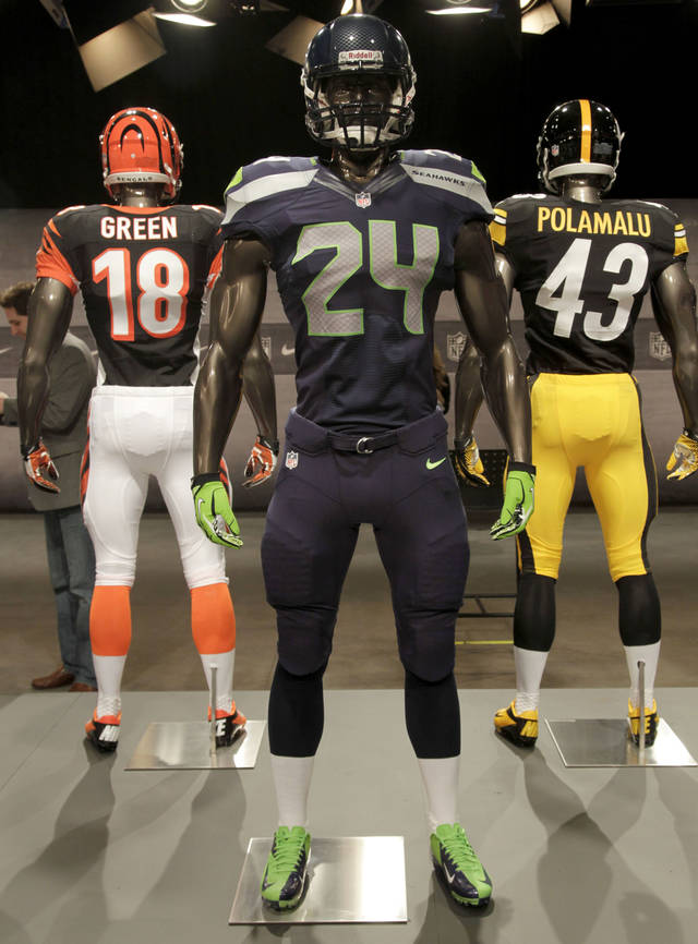 The new Seattle Seahawks uniform is displayed on a mannequin in New York, Tuesday, April 3, 2012. NFL has unveiled its new sleek uniforms designed by Nike. While most of the new uniforms are not very different visually, they all are made with new technology that make them lighter, dryer and more comfortable. (AP Photo/Seth Wenig)