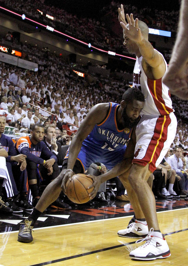 Oklahoma City's James Harden (13) tries to get around Miami's Shane Battier (31) during Game 3 of the NBA Finals between the Oklahoma City Thunder and the Miami Heat at American Airlines Arena, Sunday, June 17, 2012. Oklahoma City lost 91-85.  Photo by Bryan Terry, The Oklahoman