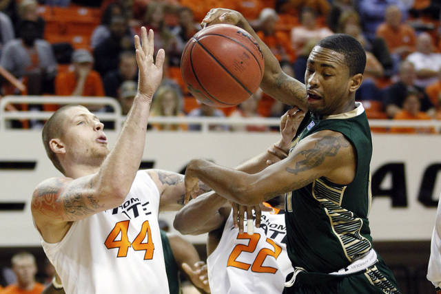 South Florida's Anthony Collins, right, loses control of the ball in front of Oklahoma State forward Philip Jurick (44) and guard Markel Brown (22) in the second half of an NCAA college basketball game in Stillwater, Okla., Wednesday, Dec. 5, 2012. Oklahoma State won 61-49. (AP Photo/Sue Ogrocki)