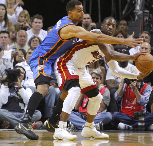 Oklahoma City's Thabo Sefolosha (2) defends Miami's Dwyane Wade (3) during Game 4 of the NBA Finals between the Oklahoma City Thunder and the Miami Heat at American Airlines Arena, Tuesday, June 19, 2012. Photo by Bryan Terry, The Oklahoman
